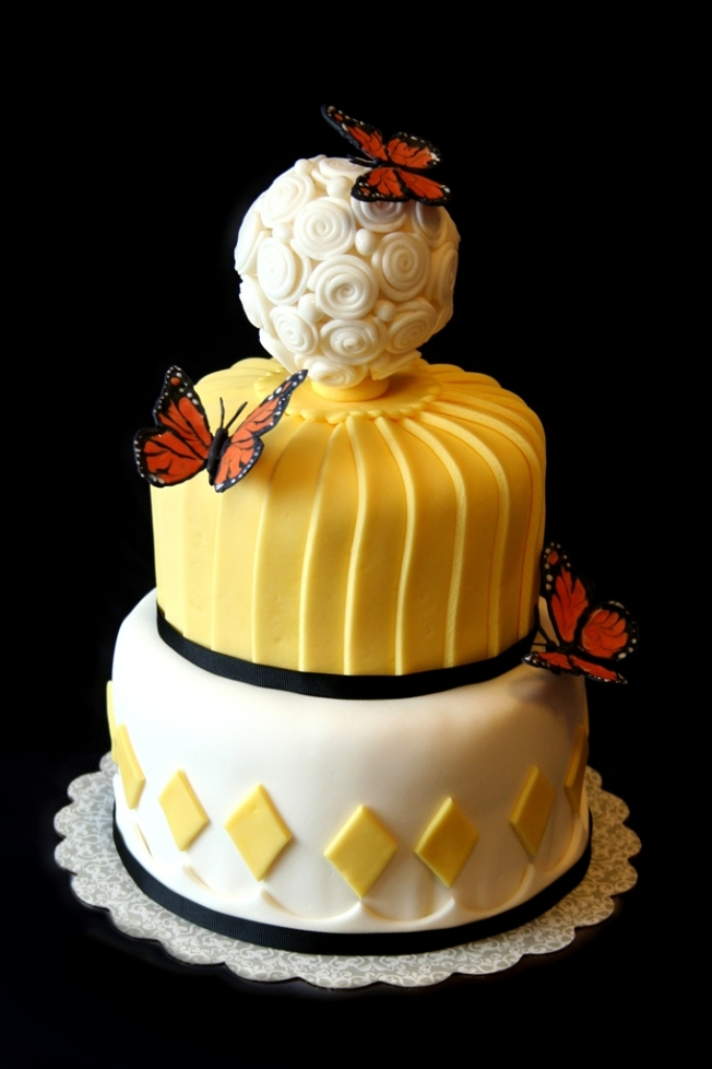 denna's ideas: black and yellow butterfly stacked layer cake