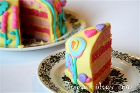 Sunshine, lollipops and rainbows cake