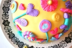 """Sunshine, lollipops and rainbows"" cake"