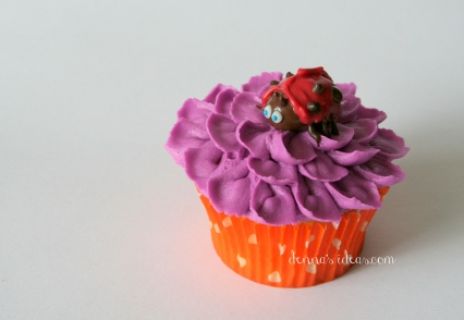 Purple flower and chocolate ladybug