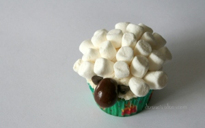 denna's ideas: chocolate covered almonds as cupcake toppers, little marshmallow sheep cupcake