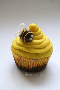 denna's ideas: chocolate covered almonds as cupcake toppers, bee on a bee hive cupcake