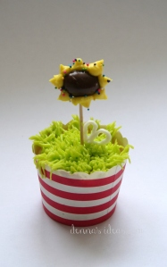 denna's ideas: chocolate covered almonds as cupcake toppers, sunflower topper