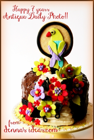 Colorful parrot cookie and fondant flowers